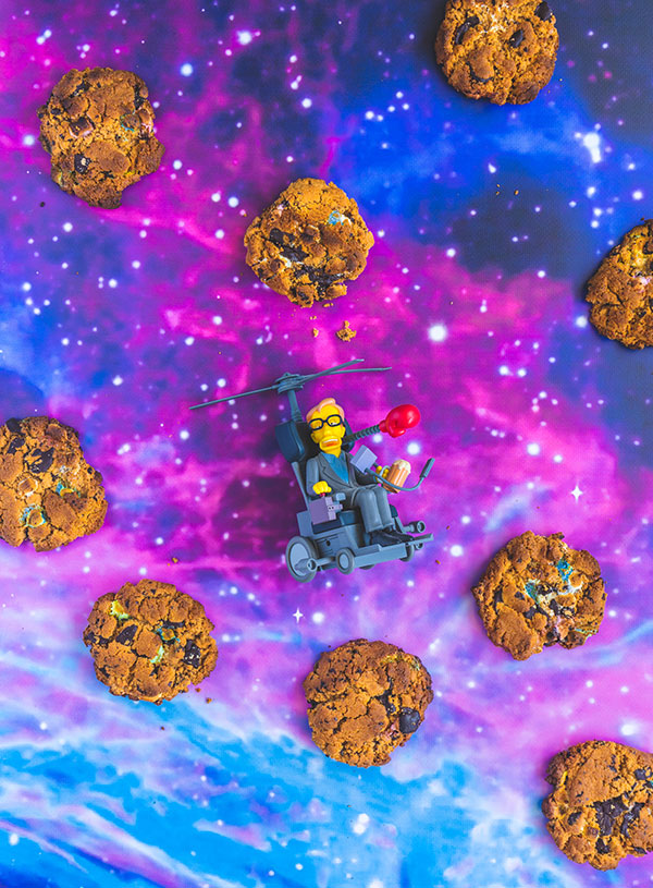 Peanut butter smores cookies floating in space with a Simpsons action figure of Stephen Hawking
