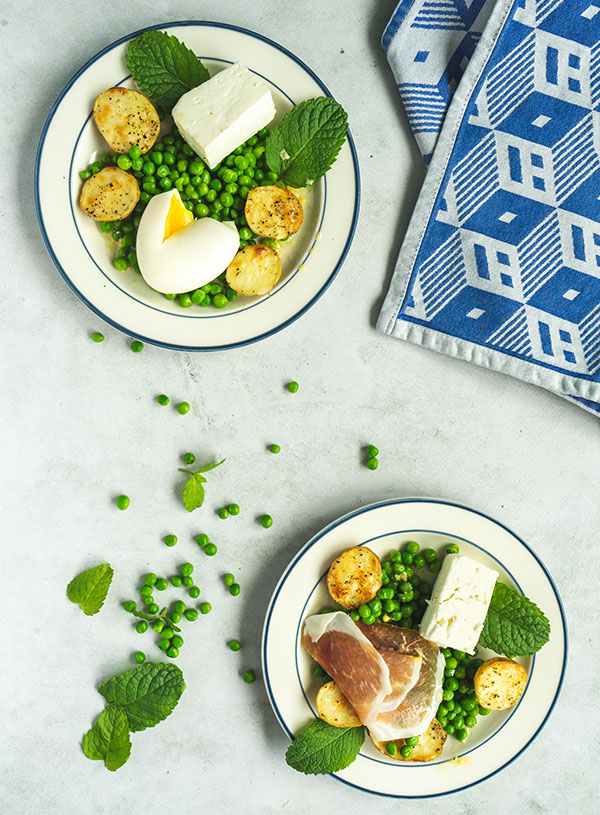 Two plates of Donna Hay's pea, mint and feta salad