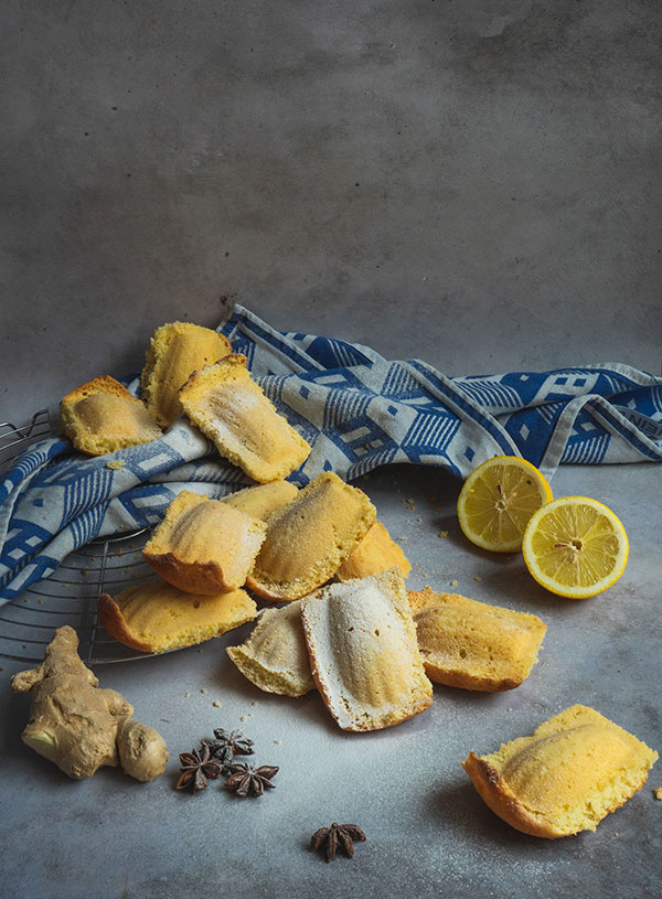 A pile of madeleines, surrounded by the key ingredients