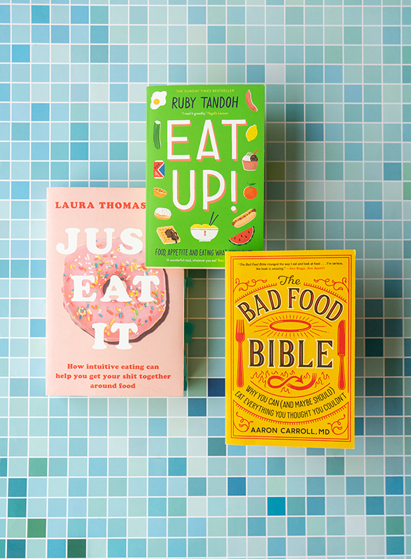 A stack of the books Just Eat it by Laura Thomas Phd, Eat up! by Ruby Tandoh and The Bad Food Bible by Aaron M. Carroll