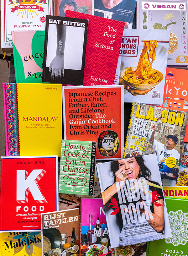 21 Asian cookbooks scattered in one image together.