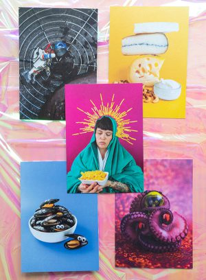 An overview of the 5 postcards described in the product page on a luminescent pink background.